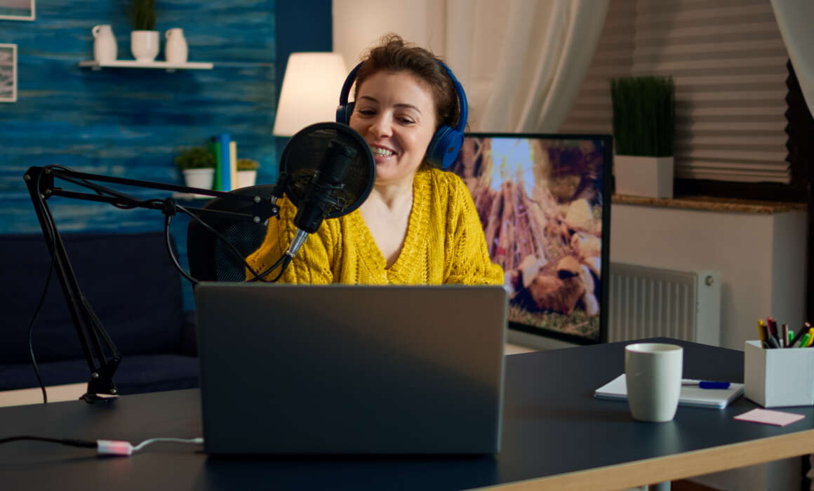 How to start your own Podcast, a practical guide  How to start your own Podcast, a practical guide influencer wearing headphones recording new podcas GE4MEUU 1160x700