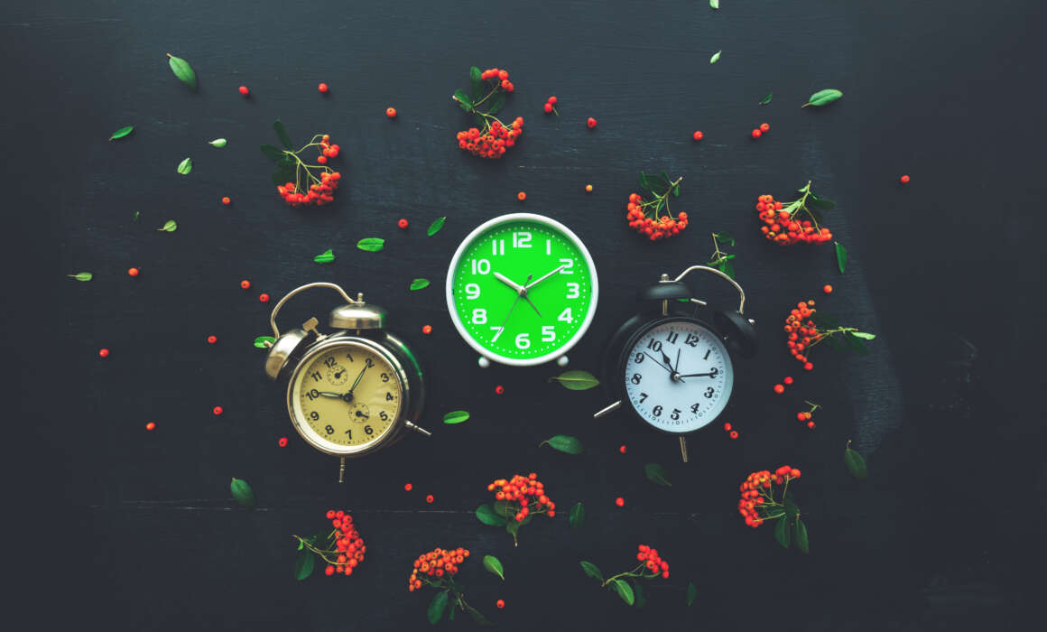 Your past does not define you! Your past does not define you! Your past does not define you! ten past ten on three alarm clocks flat lay EAYGBM2 1160x700
