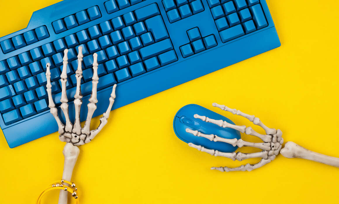 Don't Be Fooled by the Single Serving Friend Society  Don't Be Fooled by the Single Serving Friend Society human skeleton hands typing on blue computer keybo 6AR62U6 1160x700