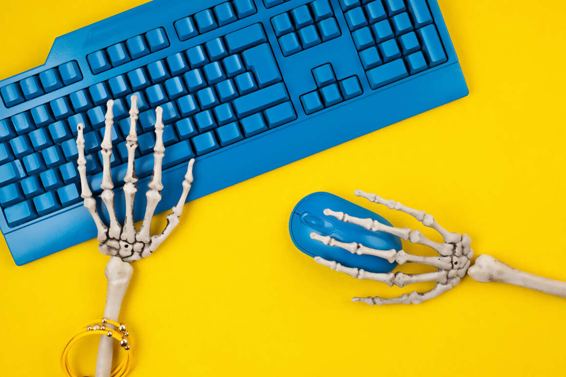 Don't Be Fooled by the Single Serving Friend Society  Don't Be Fooled by the Single Serving Friend Society human skeleton hands typing on blue computer keybo 6AR62U6 1160x773